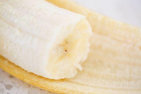 Peeled banana. Close up. Isolated on white background. - Image 写真素材 - 133611335