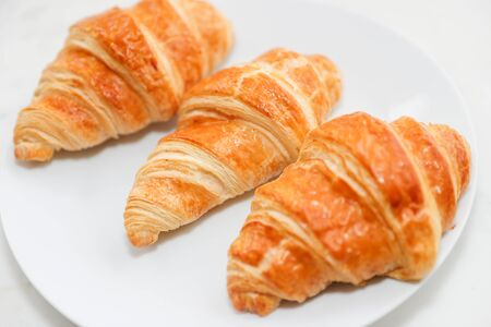 Plain croissant on white background - Image