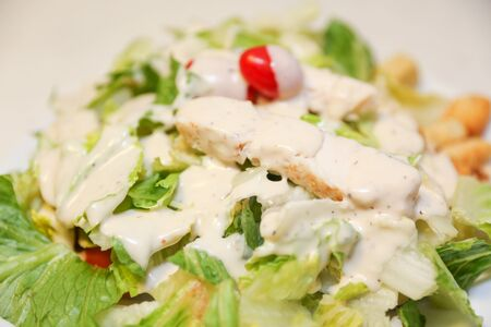 Fresh salad with chicken breast, arugula and tomato. Top view - Image
