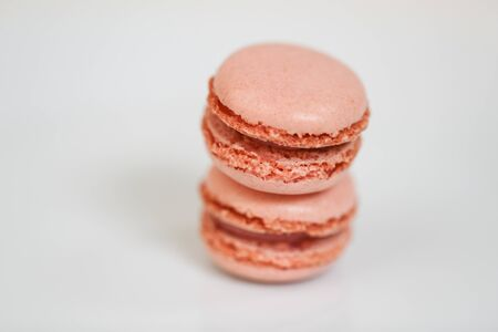 Delicious macaron sweets arranged in rows, colorful macaroon dessert on white background. -Image