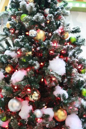 Decorated Christmas tree with colored noel ball with blurred background.- Image