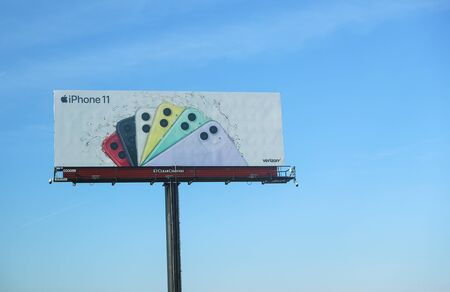 New Jersey December 26, 2019: A billboard advertising the iPhone 11 pro which on the highway-Image