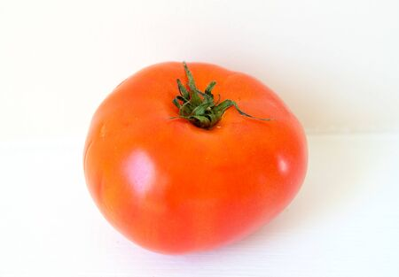 Tomato isolated in white background. Full depth of field.-Image