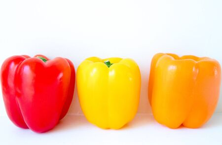 Fresh ripe bell peppers isolated on white-Image