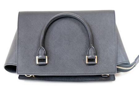 Black handbag closeup on the white background Stock fotó