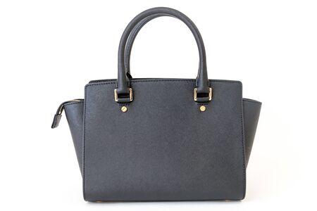 Black handbag closeup on the white background