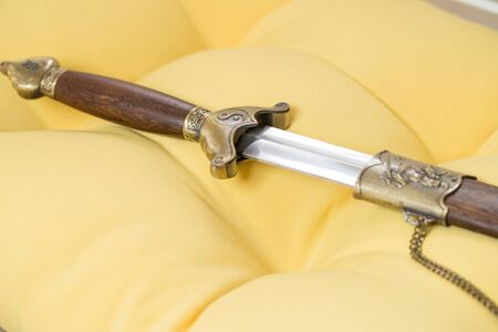 Chinese sword handle wrapped by brown wooden-Image