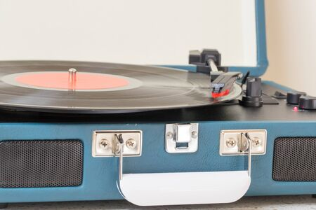 Vintage record player on the table.-Image