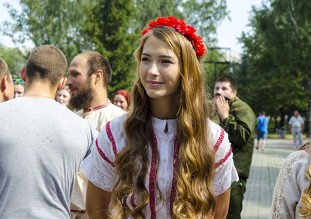 russian girl: Chelyabinsk, Russia - August 13, 2016: Russian festival of national sports Winning tradition. Beautiful Russian girl with long hair in national costume.