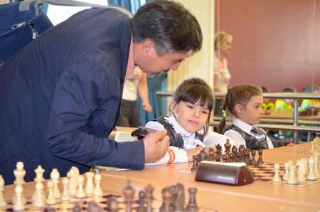 Satka, Chelyabinsk region, Russia - May 19, 2017: children play chess. Girl playing chess Editorial