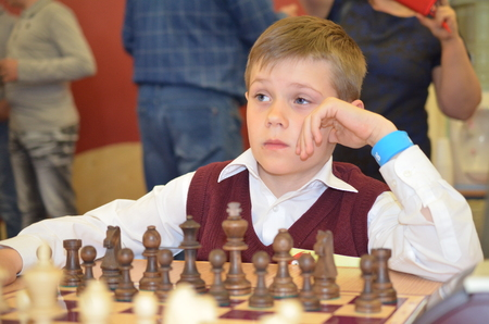 Satka, Chelyabinsk region, Russia - May 19, 2017: Competitions in chess. Boy plays chess.