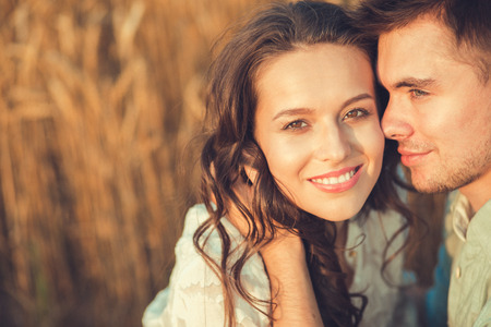 romantic couple: Young couple in love outdoor.Stunning sensual outdoor portrait of young stylish fashion couple posing in summer in field