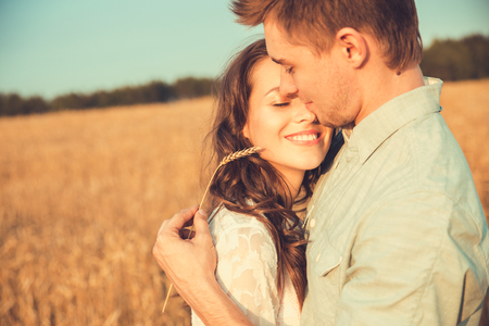 romantic love: Young couple in love outdoor.Stunning sensual outdoor portrait of young stylish fashion couple posing in summer in field