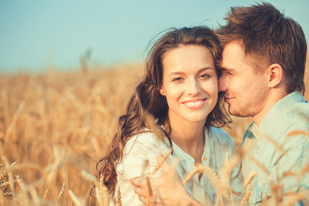 romantic beach: Young couple in love outdoor.Stunning sensual outdoor portrait of young stylish fashion couple posing in summer in field