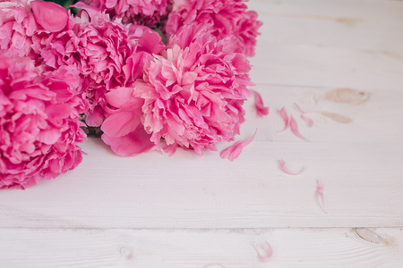 Bouquet of pink peonies on a white wooden table. Gift Valentines Day.