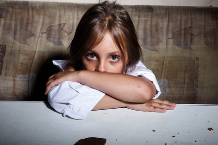 abused girl: Child abuse. Poor child in slum begging you for help concept for poverty or hunger people,