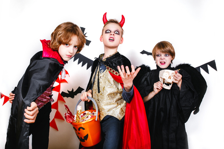 Laughing funny children in costumes in halloween.Trick or Treat Stock Photo