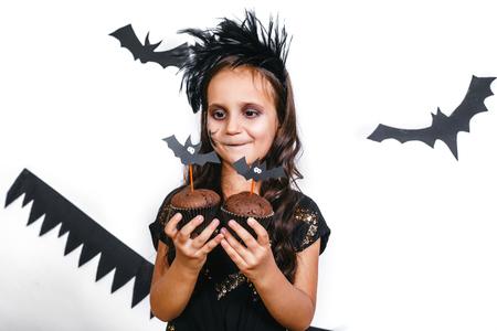 Happy girl in a halloween costume having fun Stock Photo
