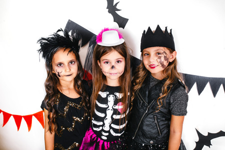 Children in halloween costumes show funny faces Stock Photo