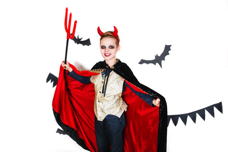 tweens: holiday halloween. funny child in carnival costumes devil on a white background Stock Photo
