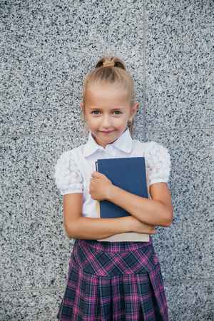 Back to school. Portrait of beautiful young schoolgirl, education concept