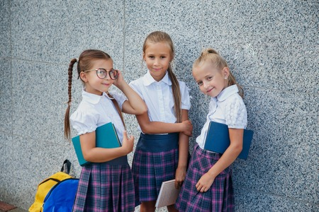 Portrait of young kids first day of school outdoor Reklamní fotografie