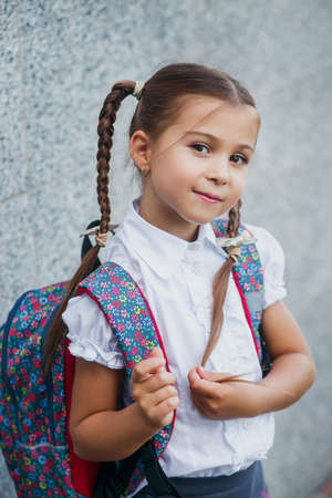 Happy little schoolgirl with backpack . Back to school outdoor Reklamní fotografie