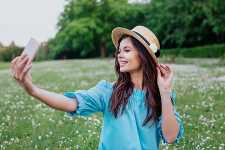 women happy smile taking photos and Selfie on relaxing time at the meadow Reklamní fotografie
