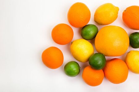 Citrus fruits - orange, lemon, grapefruit and lime on white background.