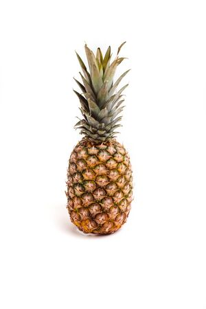 single ripe pineapple fruit on white background