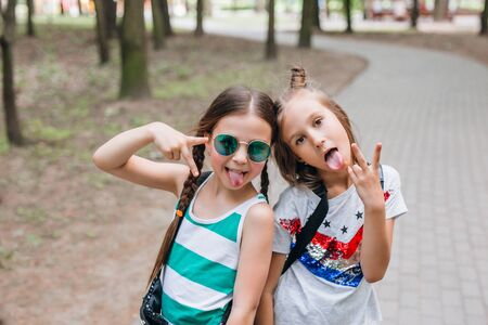 Fashion kids. Two Stylish little girls in sunglasses having fun in city Reklamní fotografie