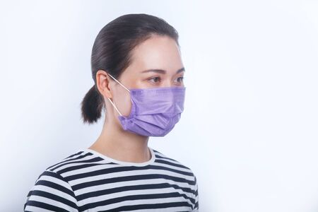 Asian women wear protective mask. Conception about health-care Reklamní fotografie