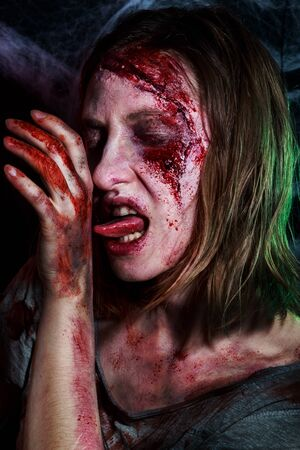 portrait of horrible zombie woman with wounds. Horror. Halloween make-up and costume