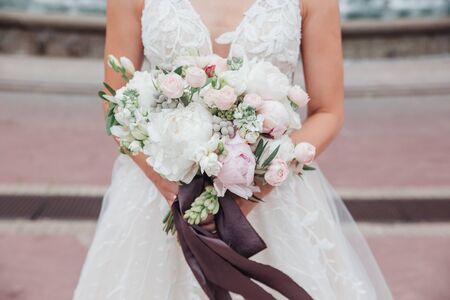 wedding bouquet in brides hands outdoor in wedding day Stock fotó