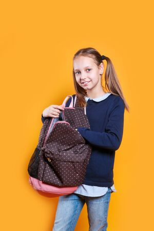 Young caucasian kid student with a backpack portrait Imagens