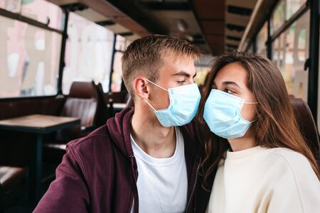 COVID-19 Pandemic Coronavirus Couple home isolation auto quarantine wearing face mask protective for spreading of disease virus