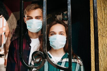 Couple in protective medical mask on face on street. Covid-19 virus quarantine concept.