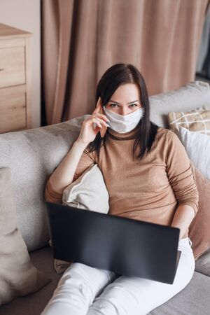 business woman working from home office , wearing protective mask Foto de archivo