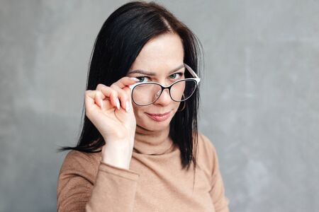 businesswoman in glasses looking at camera