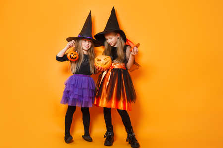 Children in halloween costumes show funny faces 免版税图像
