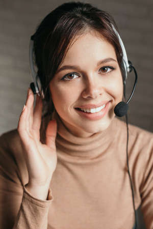 Close-up of call center operator with headphones