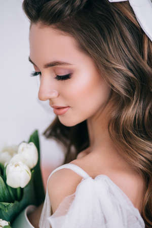 Beauty close-up portrait of bride with luxury make-up and hairstyle. Wedding make-up