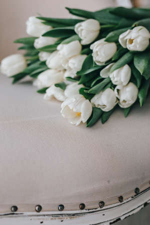 Romantic wedding bouquet of white tulips. Spring flowers