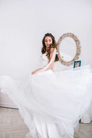 Charming and beautiful bride in luxury fashion wedding dress in studio. Happy Wedding day