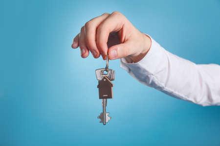 Close-up image of estate agent giving house keys Фото со стока