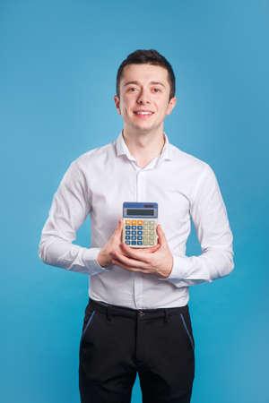 Agent businessman holding calculator on blue background