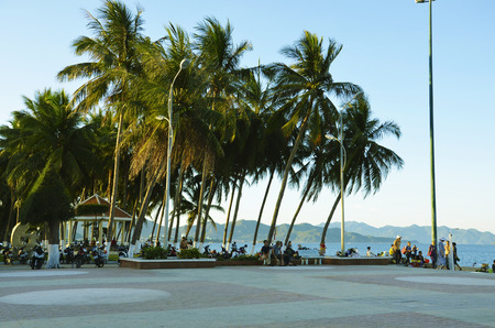 seafront: Seafront in Nha Trang, Vietnam. People relax by the sea