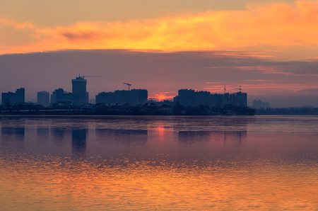 speculum: Beautiful sunset in the city. Lake sunset mirror reflection