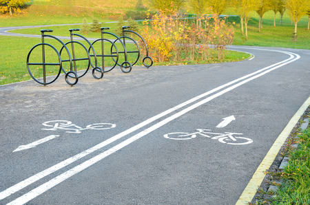 road cycling: Bicycle road in autumn. bike symbol on asphalt Stock Photo
