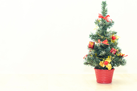 stuffer: Decorated Christmas tree on a light background Stock Photo